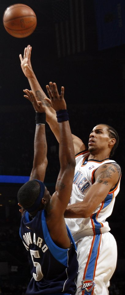 Thabo Sefolosha (2) of Oklahoma City shoots over Josh Howard (5) of Dallas in the first half during the NBA basketball game between the Dallas Mavericks and the Oklahoma City Thunder at the Ford Center in Oklahoma City, March 2, 2009. BY NATE BILLINGS, THE OKLAHOMAN