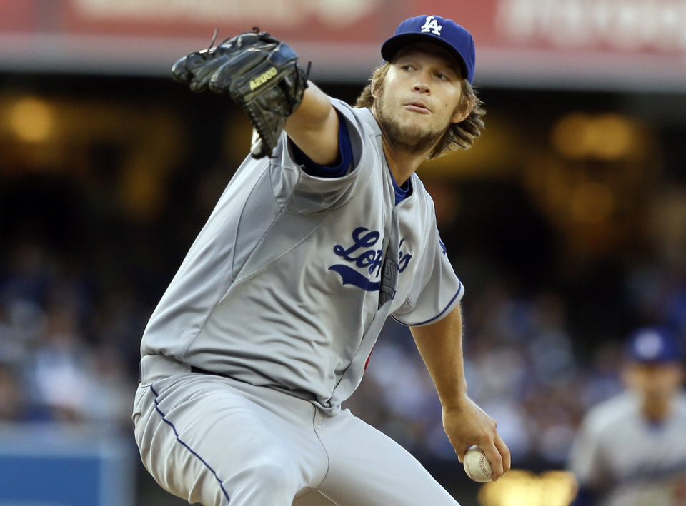 Los Angeles Dodgers starting pitcher Clayton Kershaw delivers against the San Diego Padres in the first inning of a baseball game Saturday, Sept. 21, 2013, in San Diego. (AP Photo/Lenny Ignelzi)