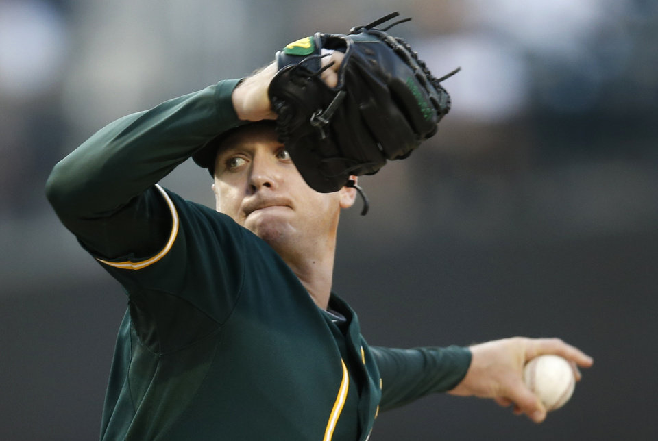 Photo - Oakland Athletics starting pitcher Scott Kazmir delivers in the first inning of an interleague baseball game against the New York Mets in New York, Tuesday, June 24, 2014. (AP Photo/Kathy Willens)