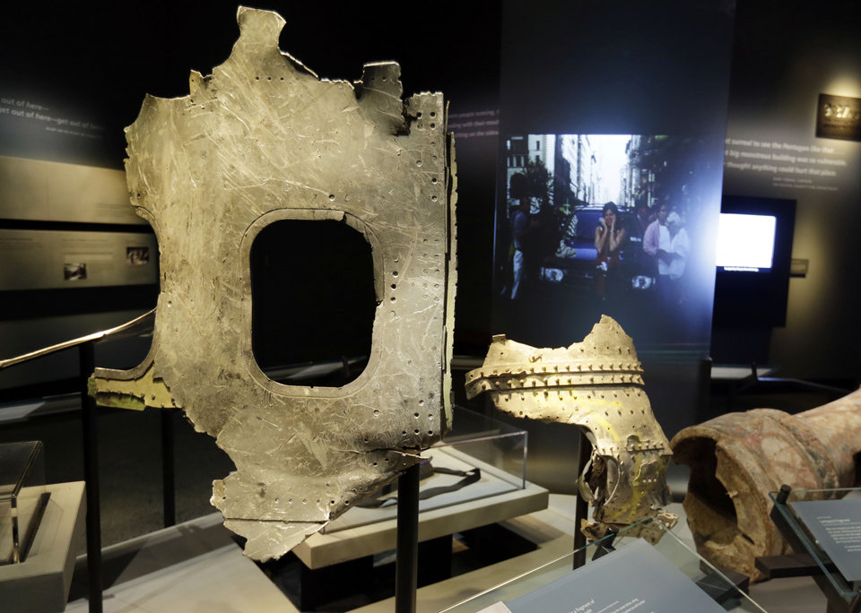 Photo - Fragments of the fuselage of Flight 11, that hit the World Trader Center, are displayed at the National Sept. 11 Memorial Museum, Wednesday, May 14, 2014, in New York. The museum is a monument to how the Sept. 11 terror attacks shaped history, from its heart-wrenching artifacts to the underground space that houses them amid the remnants of the fallen twin towers' foundations. It also reflects the complexity of crafting a public understanding of the terrorist attacks and reconceiving ground zero.  (AP Photo)