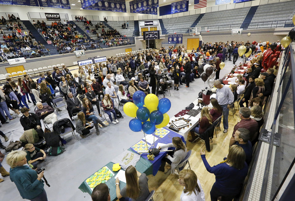 Athletes from Edmond North High School signed national letters of intent with colleges and universities during a ceremony in the school's gymnasium Wednesday morning, Nov. 13, 2013. Various sports include golf, softball, wrestling,  lacrosse and others. Photo by Jim Beckel, The Oklahoman
