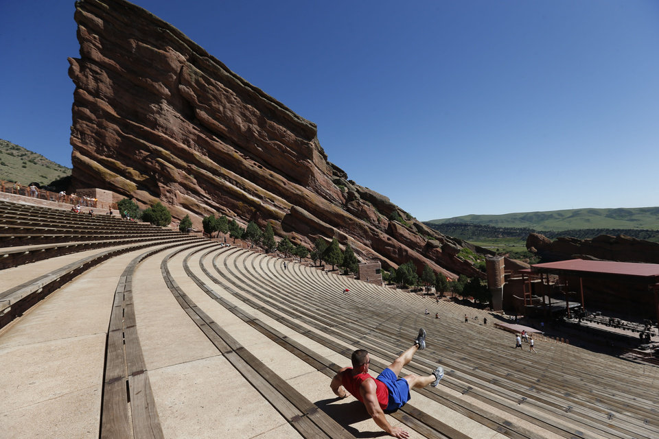 Photo - A man works out inside the amphitheater at Red Rocks Park, in Morrison, Colo., Friday, June 20, 2014. Authorities were searching Friday for a gunman who shot and wounded three people at the end of a benefit concert at the popular outdoor amphitheater near Denver on June 19. (AP Photo/Brennan Linsley)