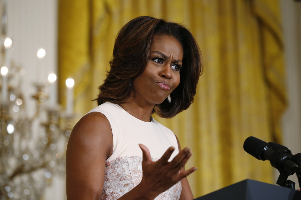 Photo - First lady Michelle Obama recites a