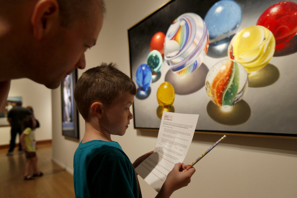 James Deaton and his son Philip Deaton, 7, gather clues for a scavenger hunt during the Oklahoma City Museum of Art's Family Day on Saturday, April 13, 2013. Photo by Bryan Terry, The Oklahoman