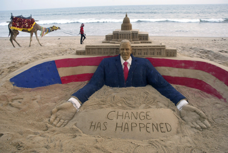 Photo - U.S. President-elect Barack Obama's sand sculpture made by an Indian artist Sudarshan Pattnaik, is seen at the golden sea beach in Puri, 67 kilometers (41 miles) away from Bhubaneswar, India, Tuesday, Jan. 20, 2009. (AP Photo/Biswaranjan Rout)