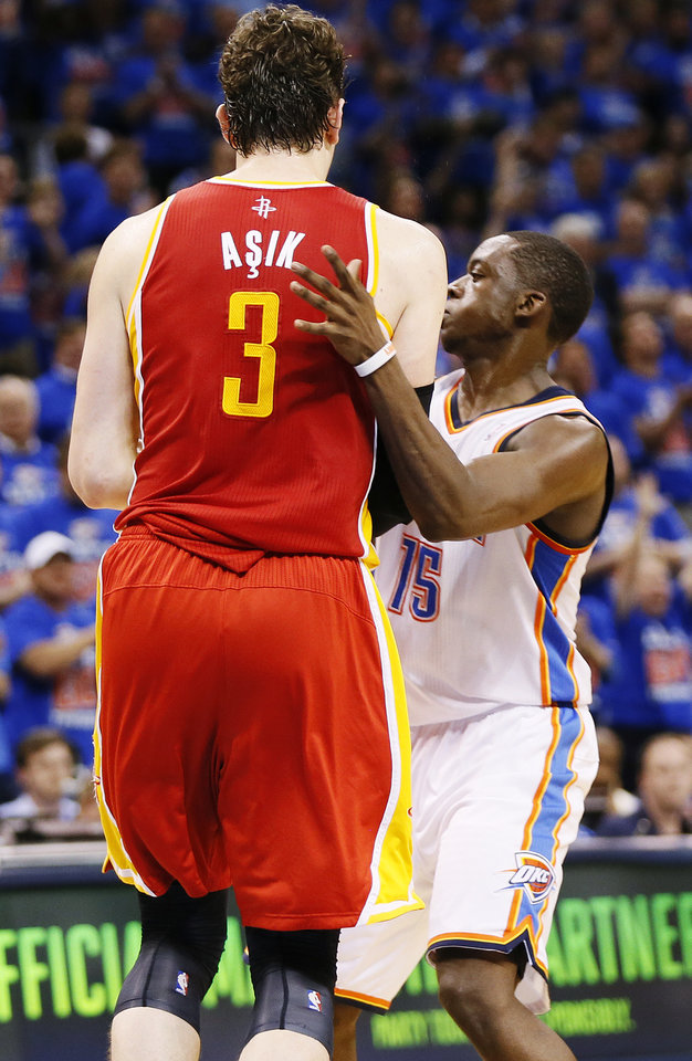 Photo - Oklahoma City's Reggie Jackson (15) intentionally fouls Houston's Omer Asik (3) in the fourth quarter during Game 5 in the first round of the NBA playoffs between the Oklahoma City Thunder and the Houston Rockets at Chesapeake Energy Arena in Oklahoma City, Wednesday, May 1, 2013. Houston won, 107-100. Photo by Nate Billings, The Oklahoman