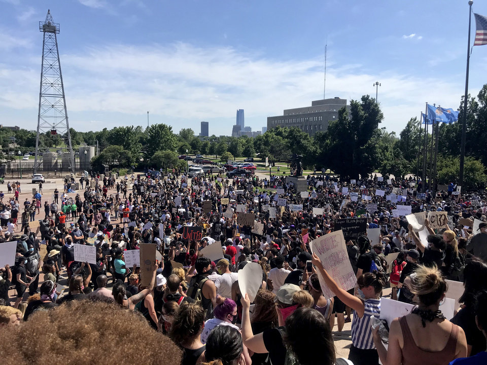Photo - Protestors rally at the State capitol during a Black Lives Matter rally in Oklahoma City,  Sunday, May 31, 2020.  [Bryan Terry/The Oklahoman]