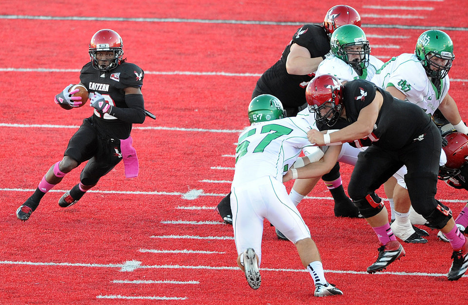 Photo -   Eastern Washington's Quincy Forte (22) runs the ball against North Dakota during the first half of an NCAA college football game on Saturday, Oct. 6, 2012, at Roos Field in Cheney, Wash. (AP Photo/The Spokesman-Review, Tyler Tjomsland) COEUR D'ALENE PRESS OUT