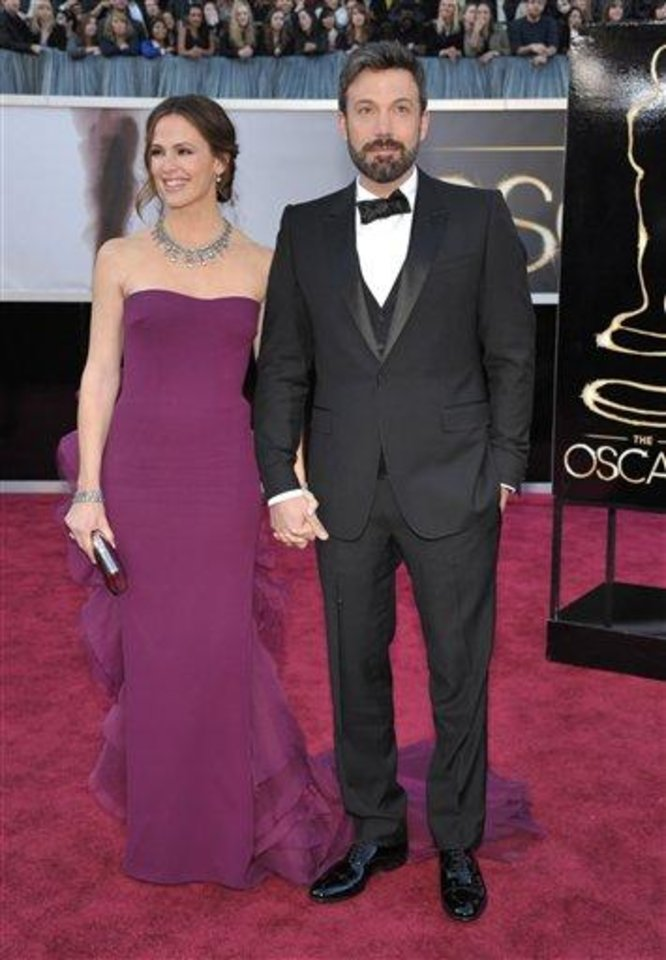 Photo - Jennifer Garner, left, and Ben Affleck arrives at the Oscars at the Dolby Theatre on Sunday Feb. 24, 2013, in Los Angeles. (Photo by John Shearer/Invision/AP)