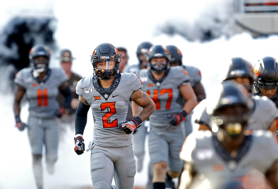 Photo - Oklahoma State's Tylan Wallace (2) runs onto the field before the college football game between the Oklahoma State Cowboys and the McNeese State Cowboys at Boone Pickens Stadium in Stillwater, Okla., Saturday, Sept. 7, 2019. [Sarah Phipps/The Oklahoman]