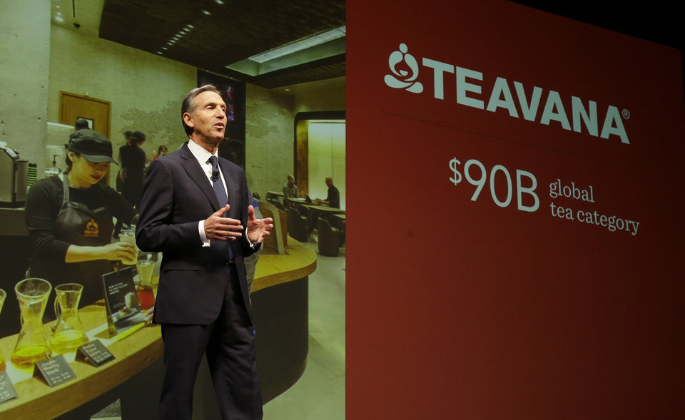Photo - Howard Schultz, chairman and CEO of Starbucks Coffee Company, talks about Starbucks' Teavana tea products, Wednesday, March 19, 2014, at the company's annual shareholders meeting in Seattle. Schultz says growth in the tea market is a key part of Starbucks' strategy for the years ahead. (AP Photo/Ted S. Warren)
