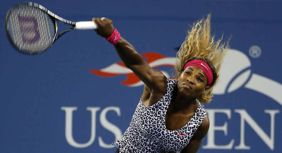 Photo - Serena Williams, of the United States, serves to Taylor Townsend, of the United States, during the opening round of the U.S. Open tennis tournament Tuesday, Aug. 26, 2014, in New York. (AP Photo/Jason DeCrow)