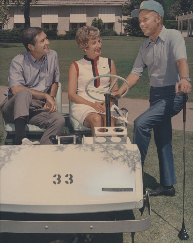 Photo - CART RIDERS JIM BROOKS, CUSHING, AND MRS. HAVEN W. MANKIN PAUSE T CHAT WITH RICHARD S. NORVILLE ABOUT PLANS FOR THE MENS TRANS-MISSISSIPPI GOLF CHAMPIONSHIP: PUBLISHED IN THE OKLAHOMAN- 7/12/70