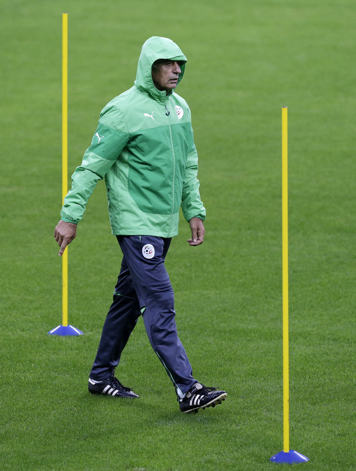 Photo - Algeria's coach Vahid Halilhodzic walks during a training session at the Arena do Gremio in Porto Alegre, Brazil, Sunday, June 29, 2014. Algeria will play against Germany on Monday in the round of 16 of the soccer World Cup. (AP Photo/Thanassis Stavrakis)