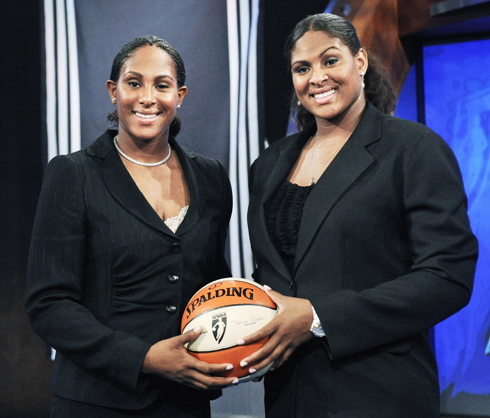 Photo - OU / ASHLEY PARIS: University of Oklahoma's twin sisters Ashley, left, and Courtney Paris pose before the WNBA draft Thursday, April 9, 2009 in Secaucus, N.J. Courtney was picked by the Sacramento Monarchs with the seventh pick overall and Ashley went to the Los Angeles Sparks in the second round with the 22nd pick. (AP Photo/Bill Kostroun) ORG XMIT: NJBK115