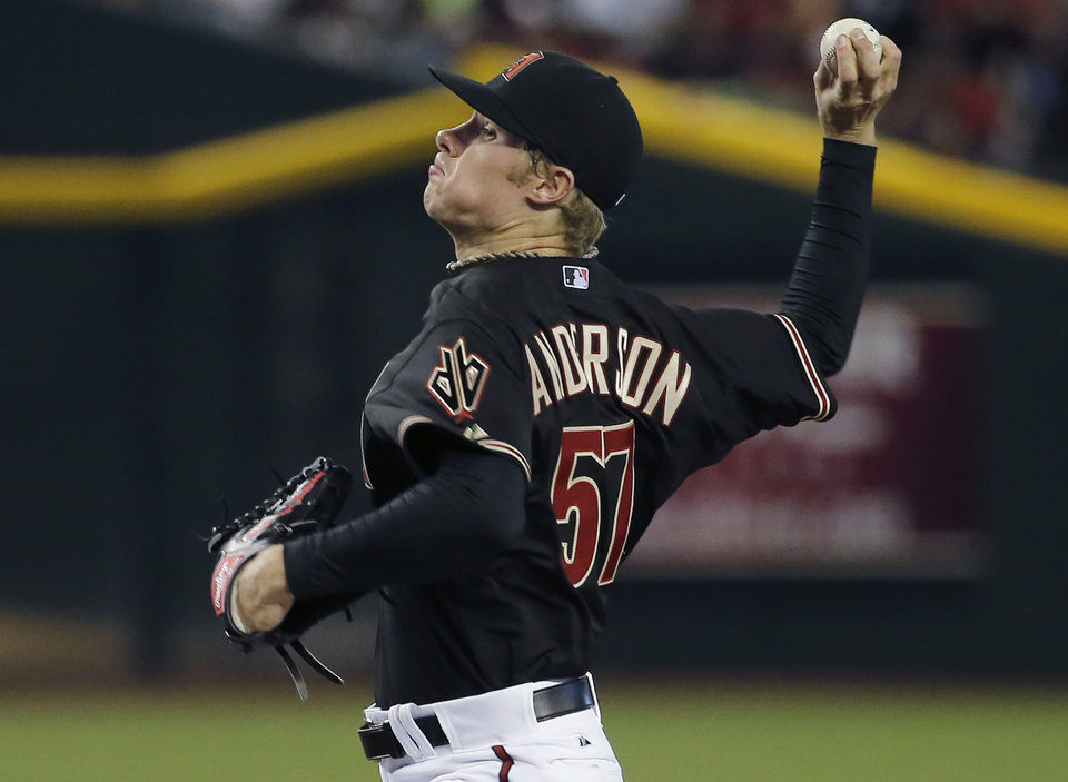 Photo - Arizona Diamondbacks pitcher Chase Anderson throws against the Los Angeles Dodgers during the first inning of a baseball game Saturday, May 17, 2014, in Phoenix. (AP Photo/Matt York)