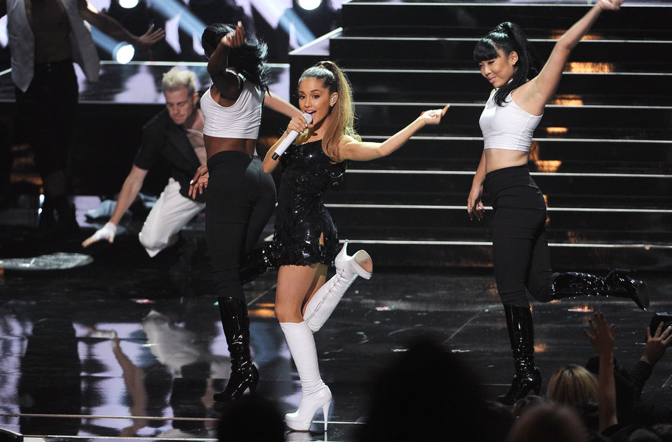 """Photo - FILE - In this May 1, 2014 file photo, Ariana Grande performs at the iHeartRadio Music Awards at the Shrine Auditorium in Los Angeles. Grande is having a breakthrough in music with the multiplatinum hit """"Problem,"""" which is spending its 13th week in the top 10 on the Billboard Hot 100 chart. The song features rapper Iggy Azalea and is from Grande's sophomore album, """"My Everything,"""" to be released Aug. 25, 2014. (Photo by Chris Pizzello/Invision/AP, file)"""