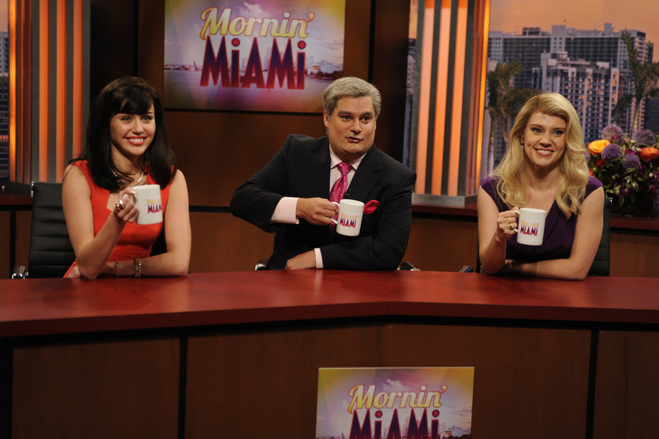 Photo - This Oct. 5, 2013 photo released by NBC shows guest host Miley Cyrus, from left, Bobby Moynihan and Kate McKinnon in a scene from the late-night comedy series