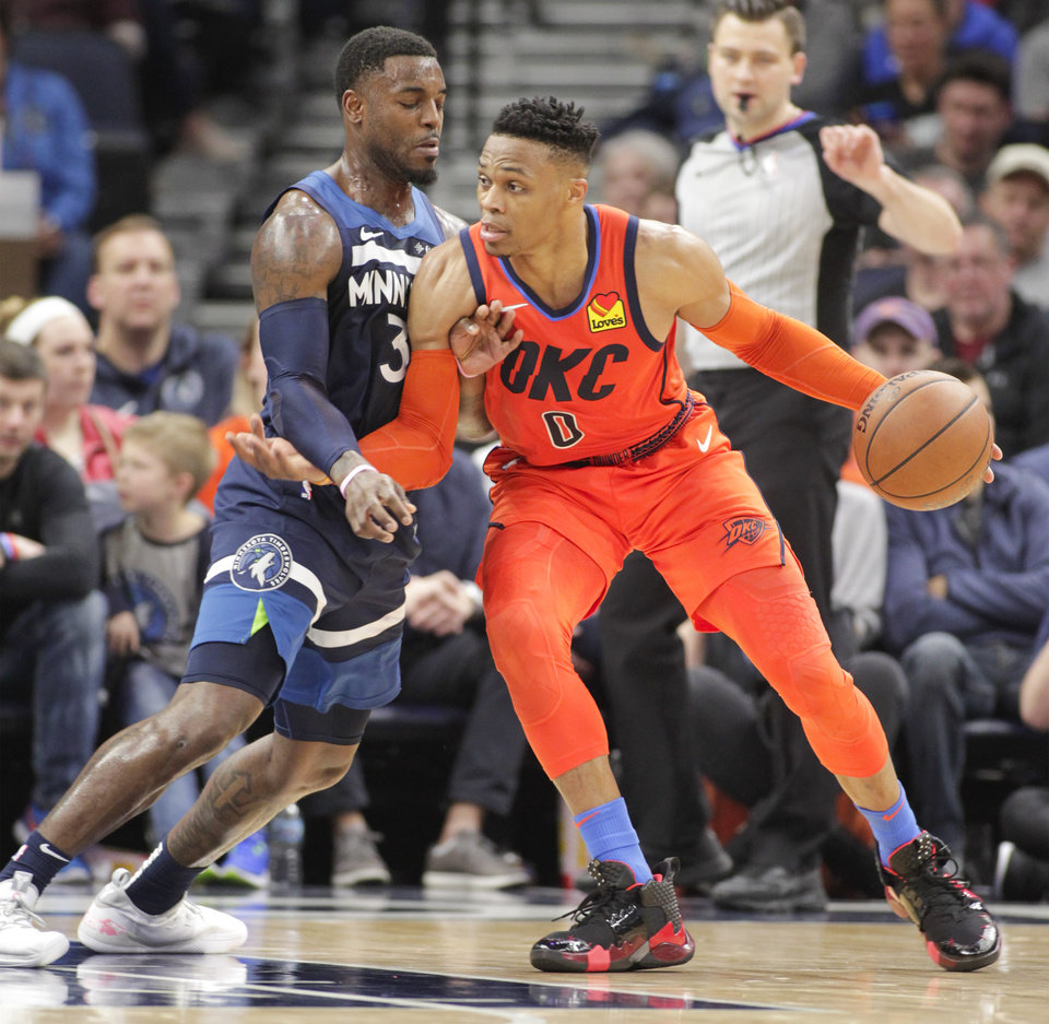 Photo - Oklahoma City Thunder guard Russell Westbrook (0) drives against Minnesota Timberwolves guard Jared Terrell (3) during the first half of a NBA basketball game Sunday, April 7, 2019, in Minneapolis. (AP Photo/Paul Battaglia)