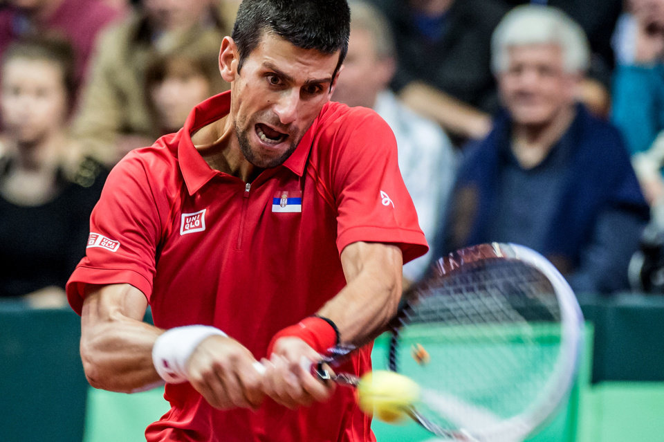 Photo - Serbia's Novak Djokovic returns the ball during the Davis Cup World Group first round match against Belgium's Olivier Rochus at the Spriroudome in Charleroi, Belgium, Friday Feb. 1, 2013. Serbia leads 1-0. (AP Photo/Geert Vanden Wijngaert)
