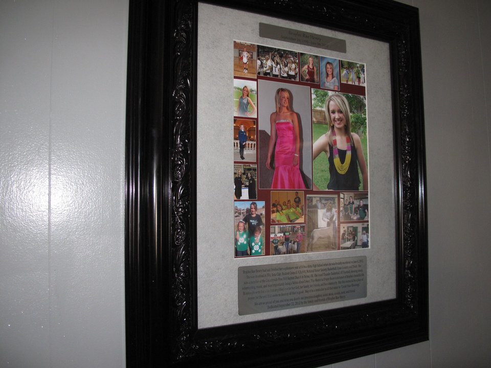 A plaque featuring pictures of Braylee Rae Henry, 16, is one of the items recently placed on the walls of the Jesus House prayer room named in her honor. <strong>CARLA HINTON - CARLA HINTON</strong>