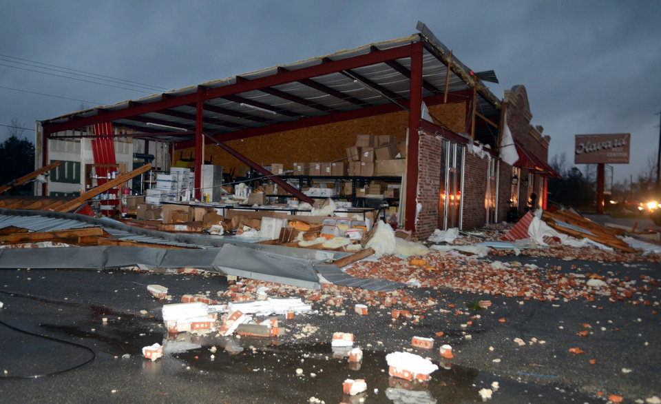 A business at 5133 Lincoln Road Extension in Hattiesburg, Miss., is damaged after an apparent tornado Sunday, Feb. 10, 2013. Major damage was reported in Hattiesburg and Petal, including on the campus of the University of Southern Mississippi. (AP Photo/Chuck Cook) ORG XMIT: MSCC129