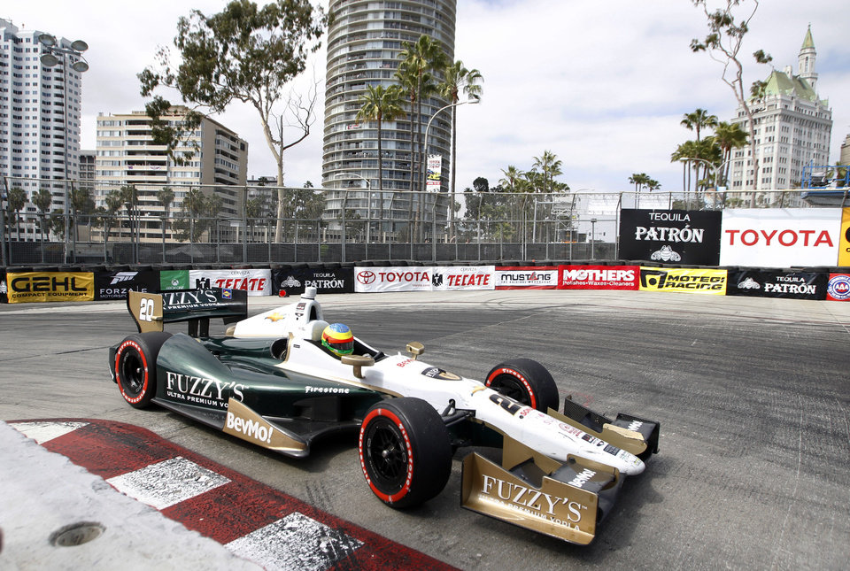 Photo - Mike Conway, of England, drives through a hairpin turn en route to winning the IndyCar Grand Prix of Long Beach auto race Sunday, April 13, 2014, in Long Beach, Calif. (AP Photo/Alex Gallardo)
