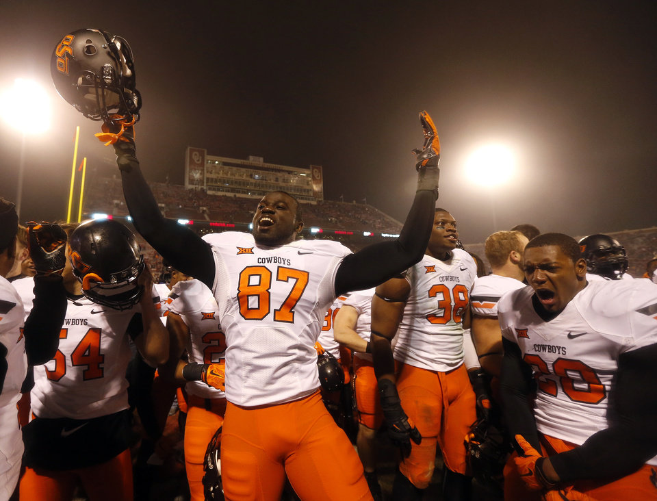 Photo - Oklahoma State celebrates during the Bedlam college football game between the University of Oklahoma Sooners (OU) and the Oklahoma State Cowboys (OSU) at Gaylord Family-Oklahoma Memorial Stadium in Norman, Okla., Saturday, Dec. 6, 2014. Photo by Sarah Phipps, The Oklahoman