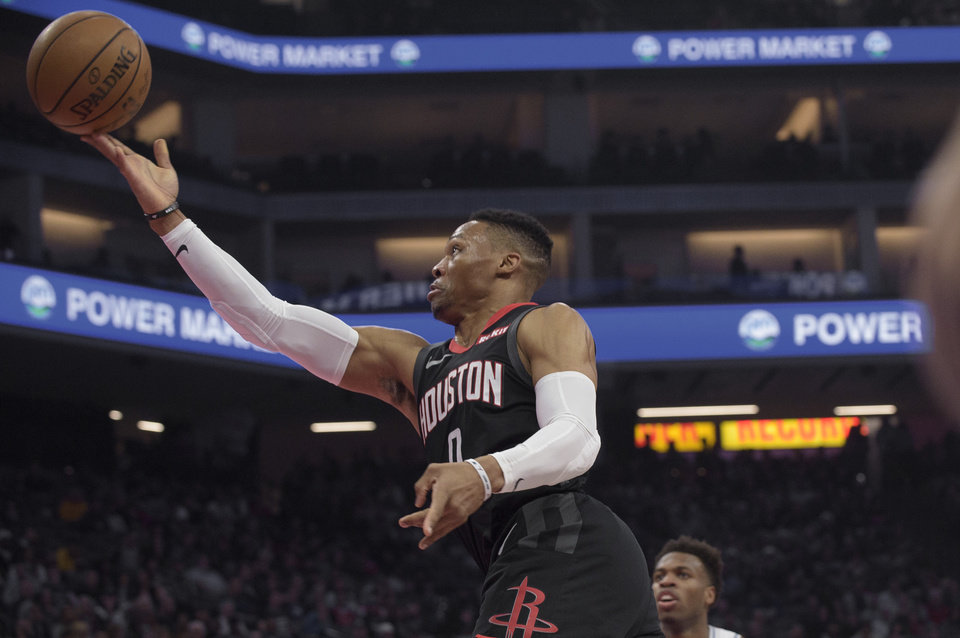 Photo - Houston Rockets guard Russell Westbrook (0) lays the ball up during the first quarter of the team's NBA basketball game against the Sacramento Kings in Sacramento, Calif., Monday, Dec. 23, 2019. (AP Photo/Randall Benton)