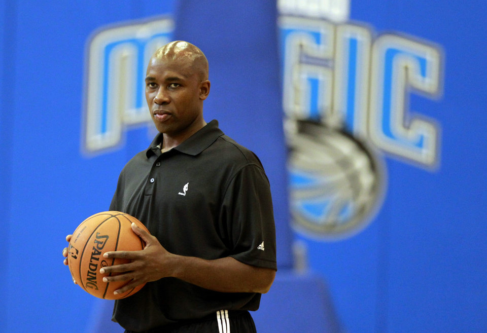 Orlando Magic head coach Jacque Vaughn watches during NBA basketball training camp in Orlando, Fla., Wednesday, Oct. 3, 2012. (AP Photo/John Raoux)