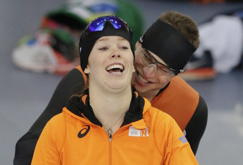 Photo - Sven Kramer of the Netherlands, right, pulls the hair of Antoinette de Jong of the Netherlands, left, as they go onto the ice for a practice at the Adler Arena Skating Center at the 2014 Winter Olympics, Friday, Feb. 14, 2014, in Sochi, Russia. (AP Photo/Matt Dunham)