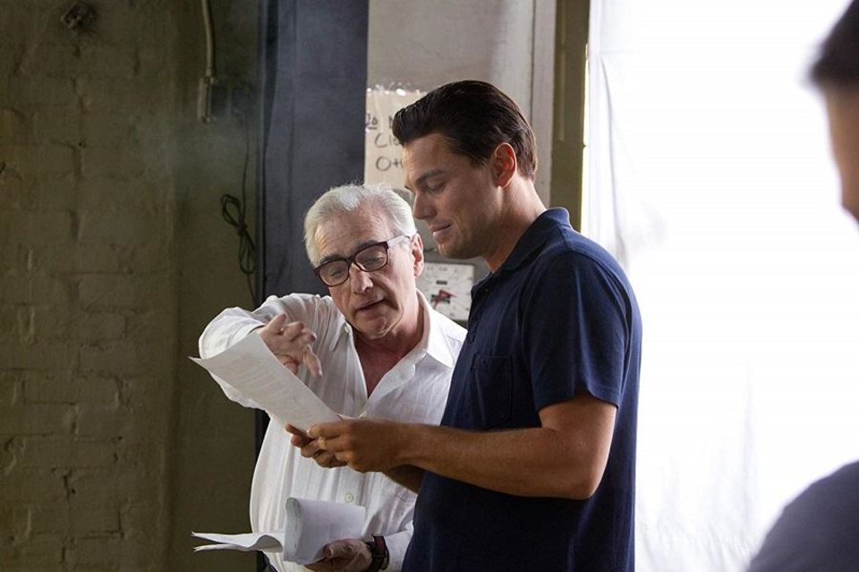 Photo - Leonardo DiCaprio, right, and Martin Scorsese work together behind the scene on the 2013 film