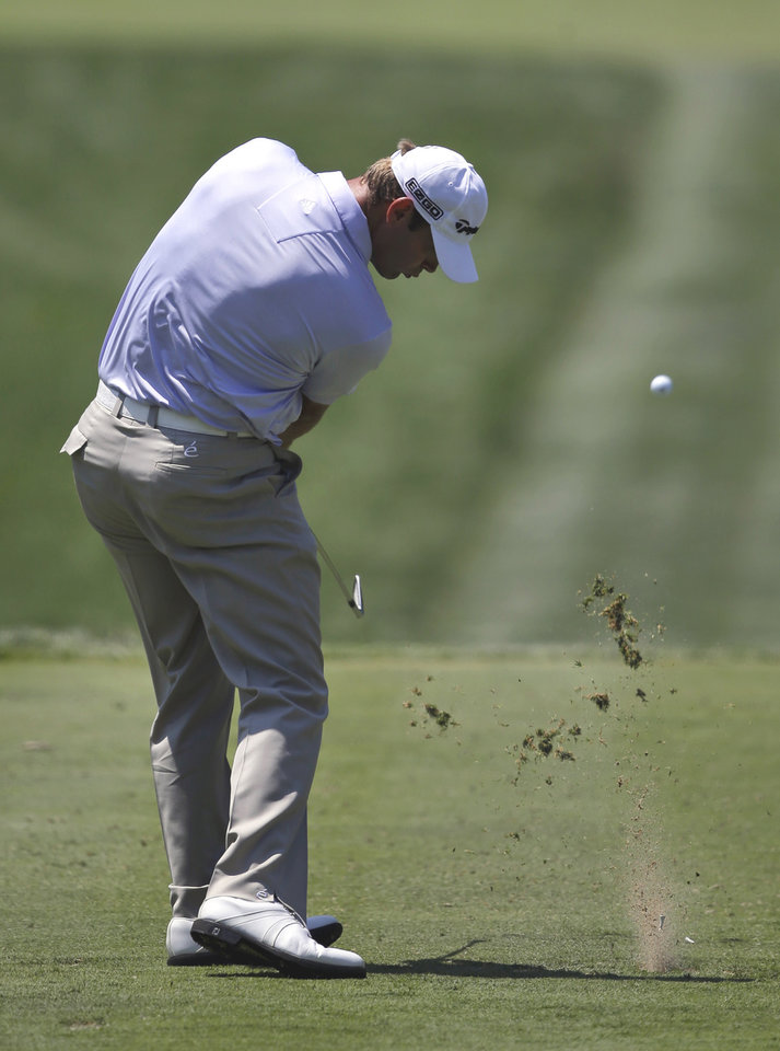 Photo - Shawn Stefani tees off on the second hole during the final round of the Quicken Loans National PGA golf tournament, Sunday, June 29, 2014, in Bethesda, Md. (AP Photo/Patrick Semansky)