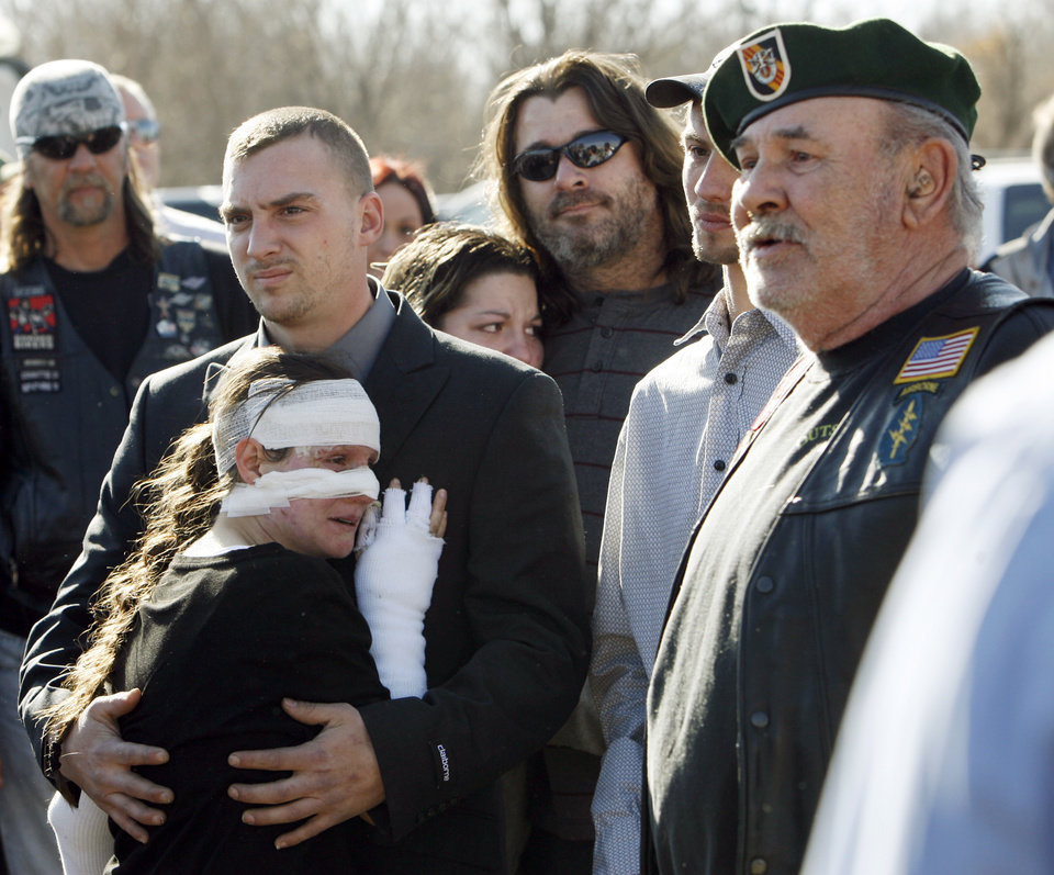 Gordon Kiselburgh, right, speaks to gathered motorcycle riders as Christopher Dunham holds his wife Stephanie Dunham before the funeral for their children, Christopher Dunham Jr., 4, Crystal Dunham, 3, and Kailey Dunham, 1, at the Sunny Lane Funeral Home in Del City, Okla., Saturday, January 15, 2011. Christopher Dunham Jr., 4, Crystal Dunham, 3, and Kailey Dunham, 1, were killed Jan. 4 when the motor home their family was living in caught fire. Stephanie Dunham was burned in the fire that killed her children and left the hospital to attend the funeral. Bikers from across the metro area were at the funeral to show support to the family. Photo by Nate Billings, The Oklahoman