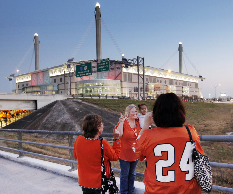 Photo - OSU fans pause for a photo before the Valero Alamo Bowl college football game between the Oklahoma State University Cowboys and the University of Arizona Wildcats at the Alamodome in San Antonio, Texas, Wednesday, December 29, 2010. Photo by Nate Billings, The Oklahoman