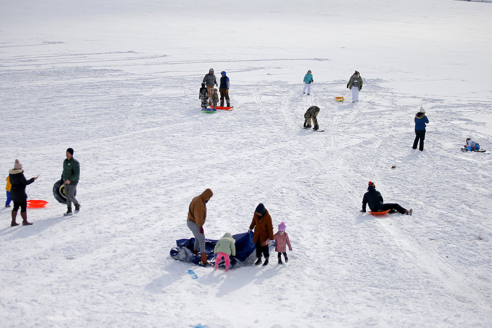 Photo - Sledders comes to a stop at the bottom of a hill along W Hefner Road in Oklahoma City after a winter storm dropped another layer of snow in Oklahoma City, Wednesday, Feb. 17, 2021. [Bryan Terry/The Oklahoman]