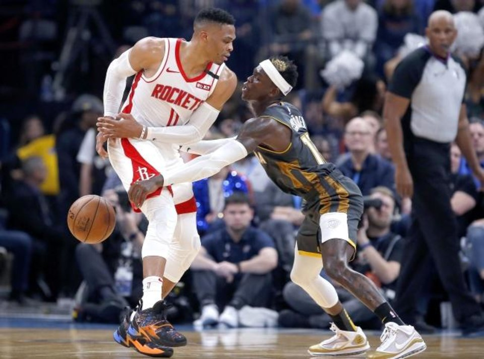 Photo -  Oklahoma City's Dennis Schroder (17) defends against Houston's Russell Westbrook (0) on Jan. 9.  [Sarah Phipps/The Oklahoman]