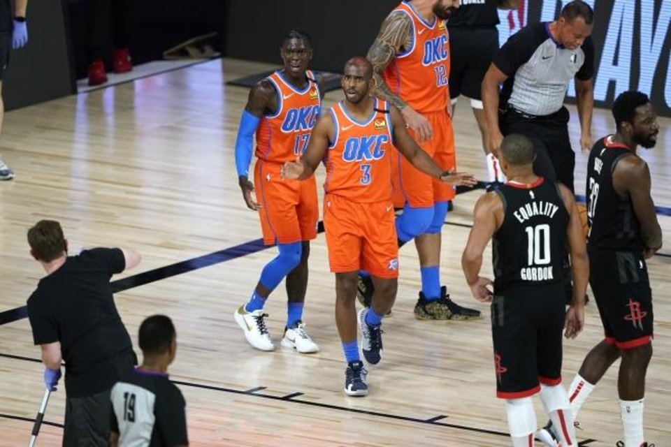 Photo -  Oklahoma City Thunder's Chris Paul (3) looks to referee James Capers (19) during the first half of an NBA basketball first round playoff game against the Houston Rockets Saturday, Aug. 29, 2020, in Lake Buena Vista, Fla. (AP Photo/Ashley Landis)