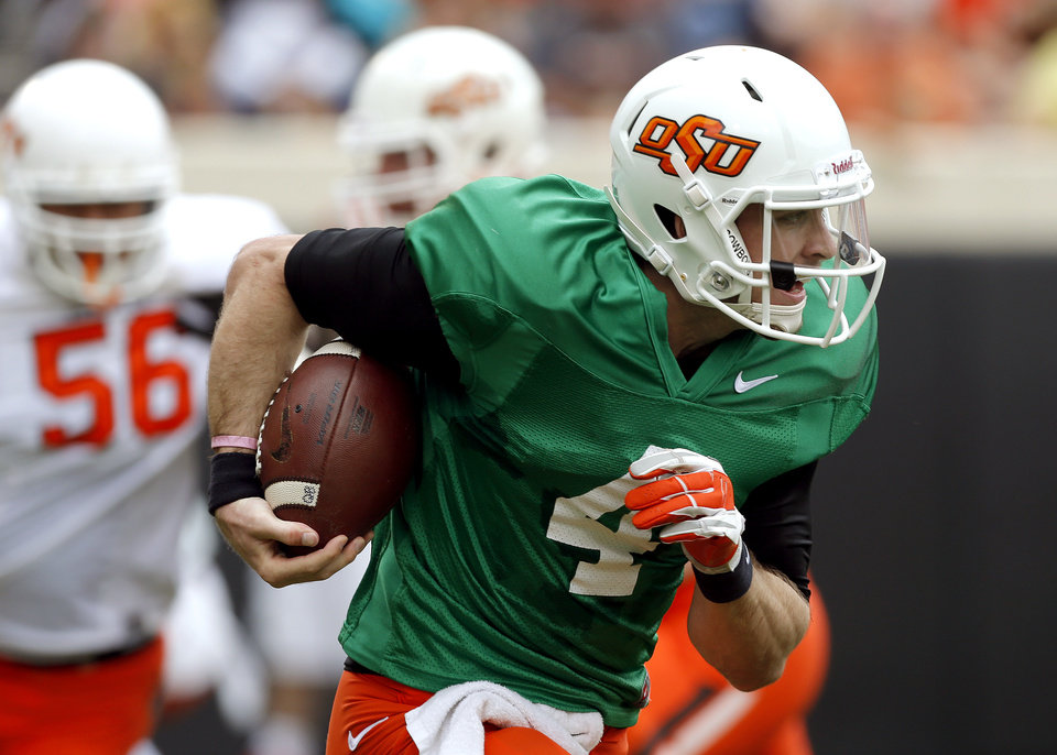 Photo - OSU's J.W. Walsh rushes during the Oklahoma State University Spring football game at Boone Pickens Stadium in Stillwater, Okla., Saturday, April, 18, 2015. Photo by Sarah Phipps, The Oklahoman