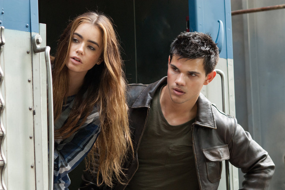 Photo -   FILE - In this undated publicity film image released by Lionsgate, Taylor Lautner, right, and Lily Collins are shown in a scene from