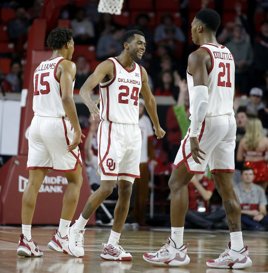 Photo - Oklahoma's Alondes Williams (15), Jamal Bieniemy (24) and Kristian Doolittle (21) celebrate during an NCAA basketball game between the University of Oklahoma Sooners (OU) and the Iowa State Cyclones at the Lloyd Noble Center in Norman, Okla., Wednesday, Feb. 12, 2020. [Bryan Terry/The Oklahoman]