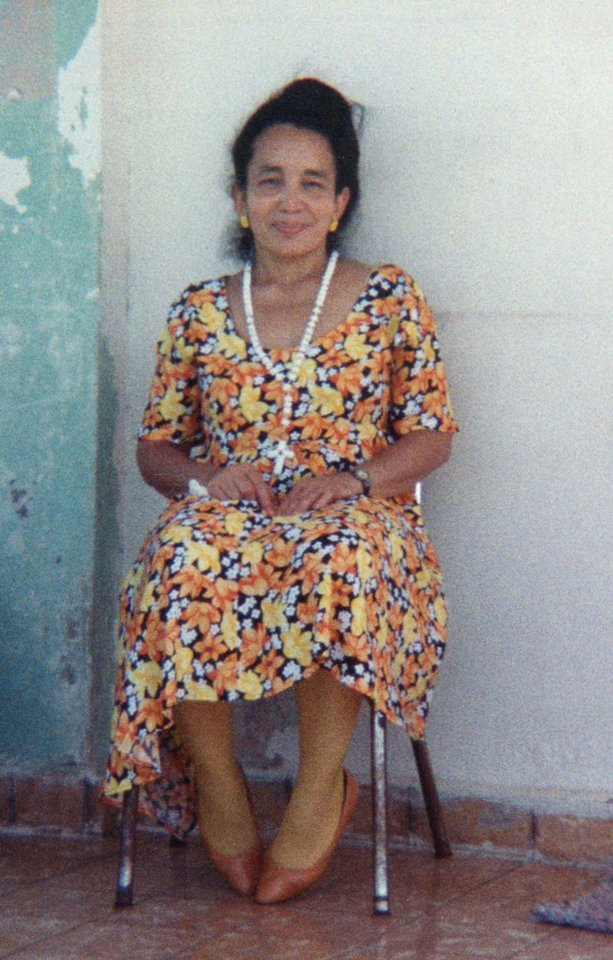 Photo - This undated family photo shows Carmen Tanco during a visit to Puerto Rico. Tanco, 67, a dental hygienist, was killed Wednesday, March 12, 2014 in gas leak-triggered explosion that reduced two buildings in the East Harlem neighborhood of New York to a pile of smashed bricks, splinters and mangled metal. Rescuers pulled four additional bodies from the rubble Thursday, raising the death toll to at least seven. (AP Photo/Photo provided by family of Carmen Tanco)