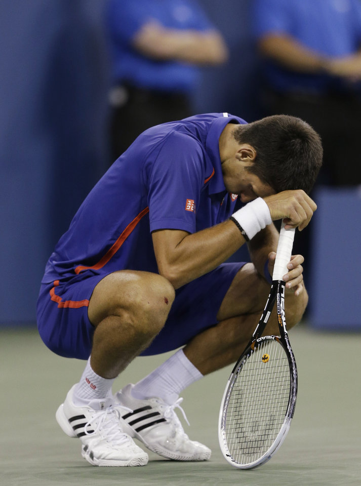Photo -   Serbia's Novak Djokovic reacts while playing Britain's Andy Murray during the championship match at the 2012 US Open tennis tournament, Monday, Sept. 10, 2012, in New York. (AP Photo/Darron Cummings)