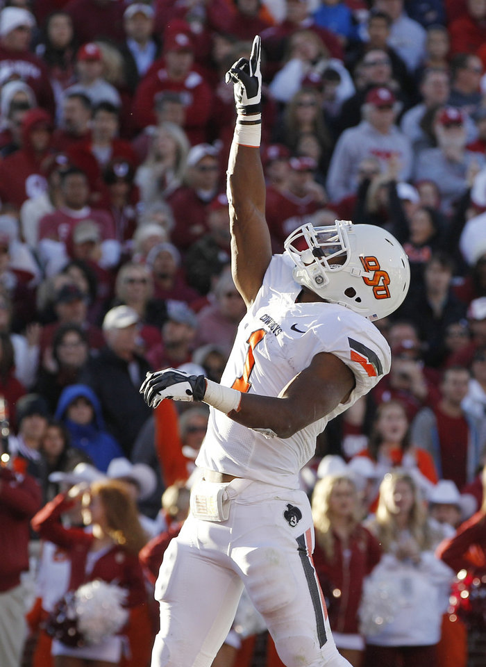 Oklahoma State running back Joseph Randle celebrates a touchdown against Oklahoma in the second quarter of an NCAA college football game in Norman, Okla., Saturday, Nov. 24, 2012. (AP Photo/Sue Ogrocki)