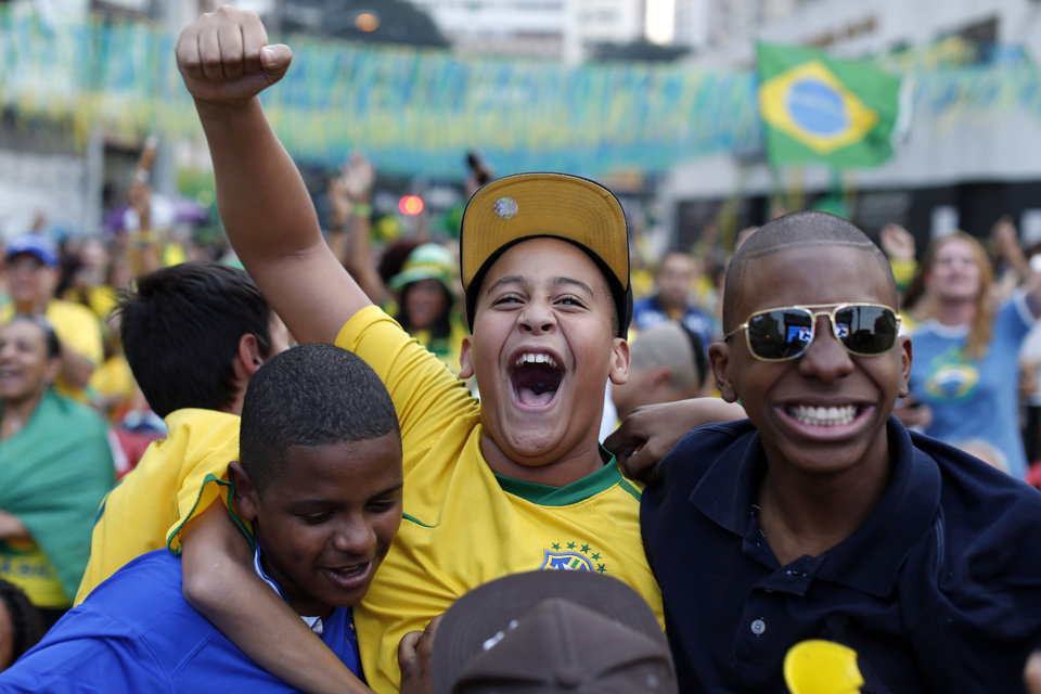 Photo - Brazil soccer fans celebrate after Brazil scored against Colombia at a World Cup quarterfinal match as they watch the game at the Vai Vai Samba school in Sao Paulo, Brazil, Friday, July 4, 2014. (AP Photo/Dario Lopez-Mills)