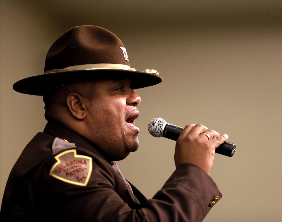 Photo - Oklahoma Highway Patrol Trooper Stan McConnell sings the national anthem during the 16th annual Midwest City Dr. Martin Luther King, Jr. Prayer Breakfast inside the Reed Conference Center Monday morning, Jan. 21, 2013. The theme of this year's event is