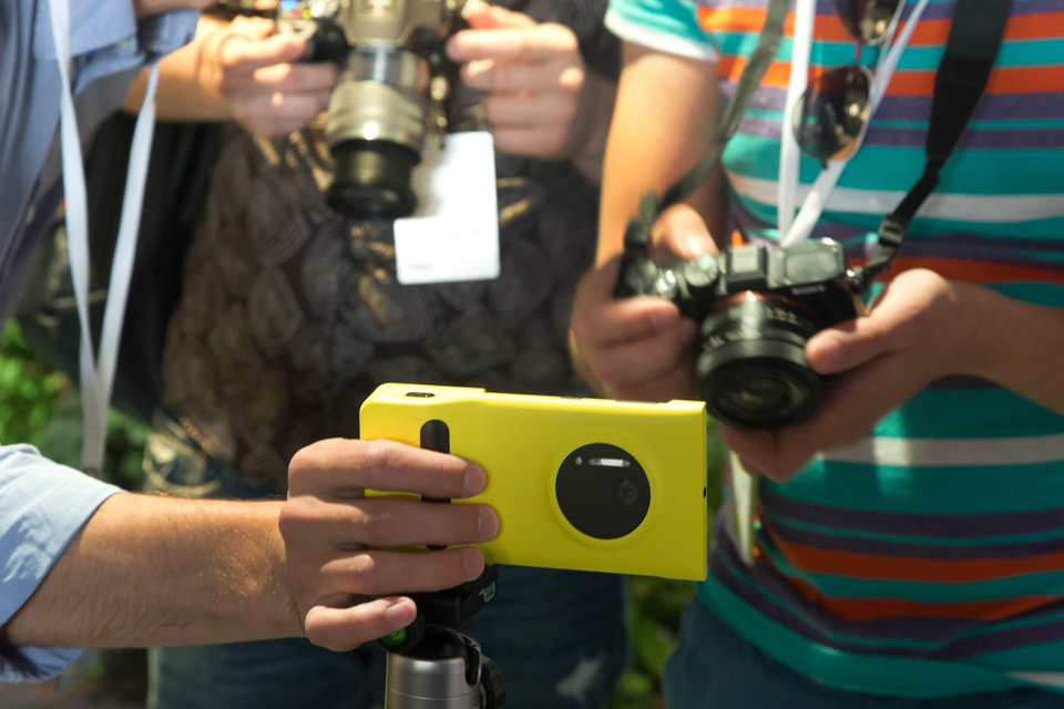 Photo - Journalists photograph a Lumia 1020 at its introduction, in New York,  Thursday, July 11, 2013. The Nokia Lumia 1020, with a 41-megapixel camera, records more detail than other camera phones and even tops point-and-shoot cameras. (AP Photo/Richard Drew)
