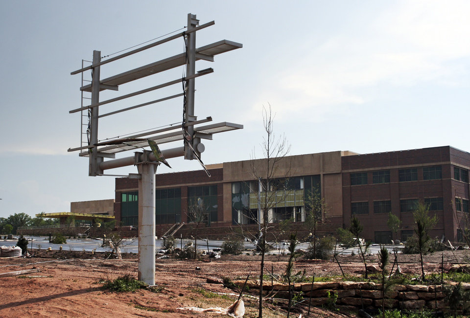 Photo - The sign is gone from the Mercy hospital under construction on I-35 after a tornado moved through Edmond, Okla., Sunday, May 19, 2013. Photo by Dave Fisk, for The Oklahoman