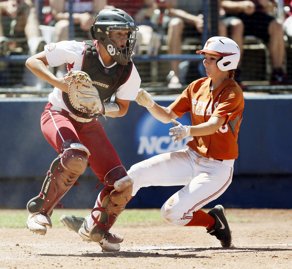 Photo - Texas' Stephanie Ceo (48) is out at home against OU catcher Jessica Shults (18) during an NCAA softball game in the Women's College World Series between Oklahoma and Texas at ASA Hall of Fame Stadium in Oklahoma City, Saturday, June 1, 2013. Oklahoma won 10-2 in five innings. Photo by Nate Billings, The Oklahoman