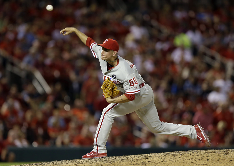 Photo - Philadelphia Phillies starting pitcher David Buchanan throws during the eighth inning of a baseball game against the St. Louis Cardinals, Thursday, June 19, 2014, in St. Louis. (AP Photo/Jeff Roberson)